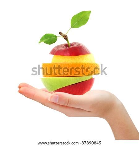Hand holding mixed fruit