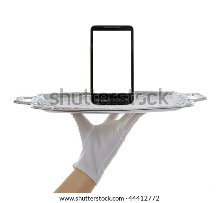 hand holding mobile phone on the silver tray
