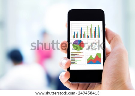 hand holding mobile phone with analyzing graph #249458413