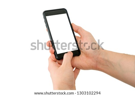 Hand holding mobile phone with blank screen using one hand and unlocking it with finger isolated. #1303102294