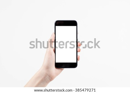 Hand holding mobile smart phone with blank screen #385479271