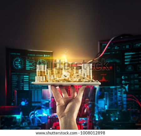 Hand holding mobile tablet with stack of bitcoin coins against the background of computer circuit boards for the crypto currency mining. Digital monitoring, checking and money exchange cryptocurrency
