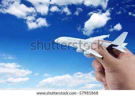 Hand holding model plane.