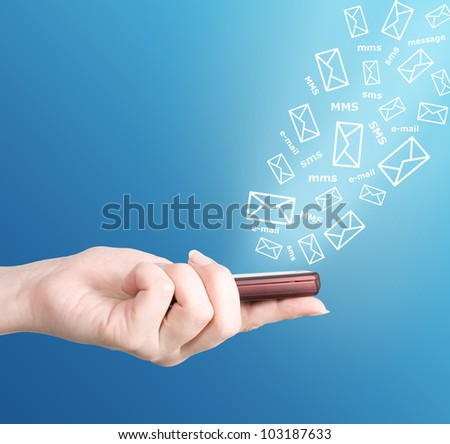 Hand holding modern mobile phone and letters flaying away. Social media concept