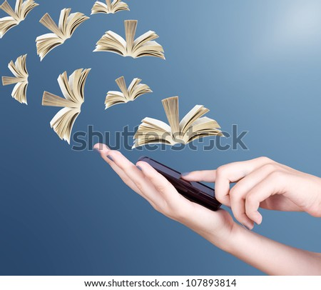 Hand holding modern mobile phone and open books flying away. Education concept