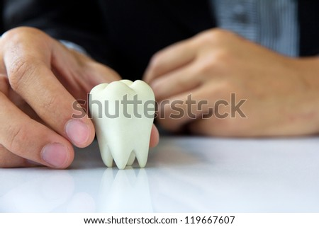 Hand holding molar,dental concept