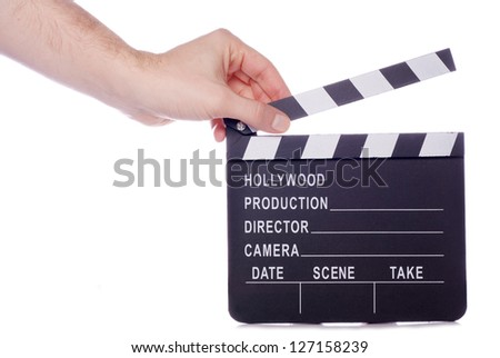 Hand holding movie clapper studio cutout #127158239