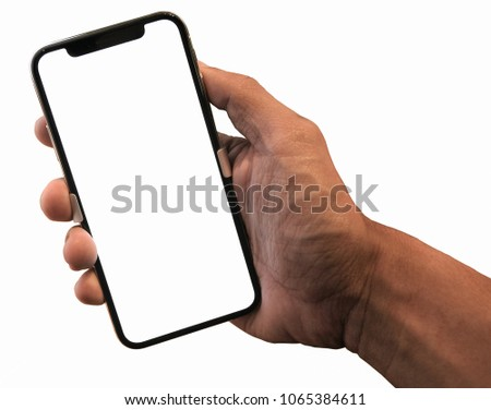 Hand holding, New version of black slim smartphone similar to iphone x with blank white screen from Apple generation 10 , Front mockup model similar to iPhonex , Background of digital economy. #1065384611