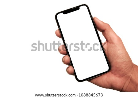 Hand holding, New version of black slim smartphone similar to iphone x with blank white screen from Apple generation 10 , Front mockup model similar to iPhonex isolated on white background #1088845673
