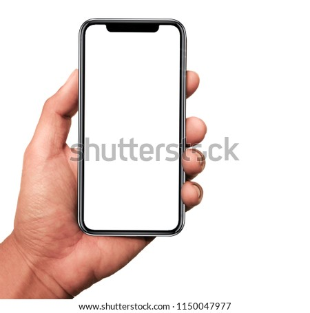 Hand holding, New version of black slim smartphone similar to iphone x with blank white screen from Apple generation 10 , Front mockup model similar to iPhonex ,Digital economy technology #1150047977