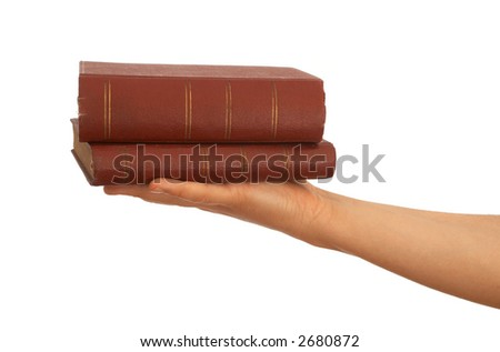 hand holding old books on white background
