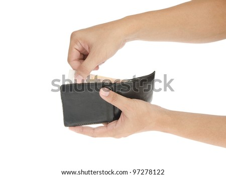Hand holding old wallet with money isolated on white background - stock photo