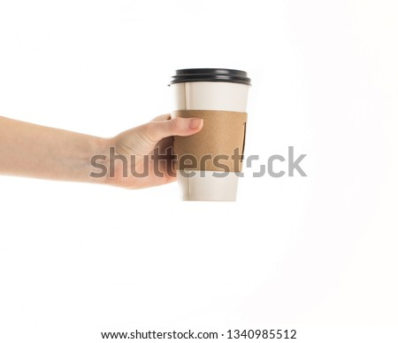 Hand holding paper mug isolated