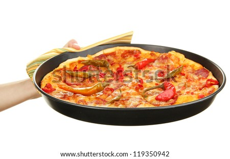 hand holding pepperoni pizza in pan isolated on white