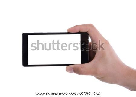 Hand holding phone isolated on white background.