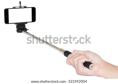 hand holding phone selfie stick isolated with clipping path #323392004