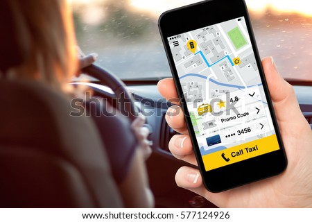 hand holding phone with application call taxi on screen background woman driving car