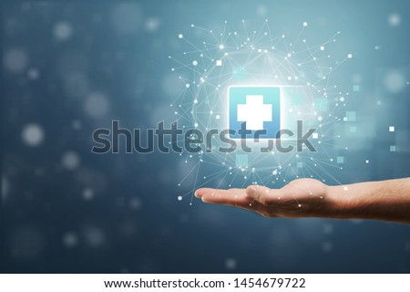 Hand holding plus sign virtual means to offer positive thing (like benefits, personal development, social network, health insurance) with copy space          - Image