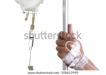 hand holding pole with iv bag on white background