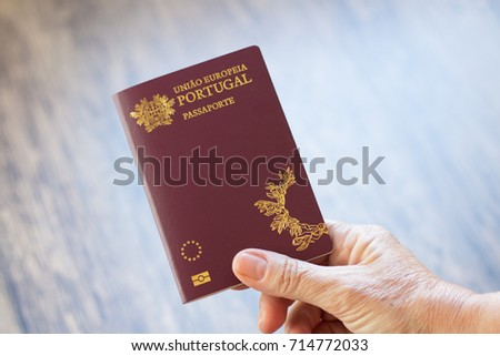 Hand holding Portuguese passport