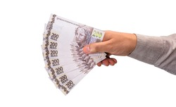 hand holding 200 reais bills, concept of brazil economy, inflation, financial crisis or loss