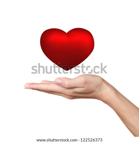 Hand holding red heart isolated on white background. Love and health concept