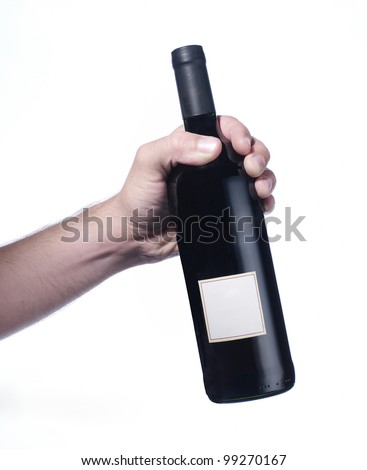 hand holding red wine bottle