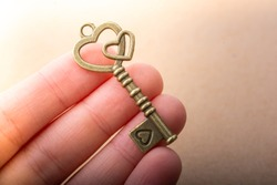Hand holding retro metal key as love  and Valentine concept