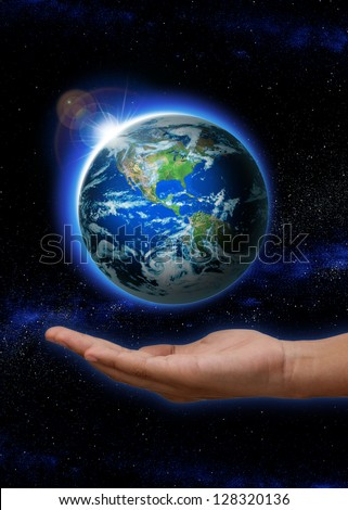 Hand  holding Rising Sun over  the world with north and south america.  hand with Planet earth with sunrise in space globe on it. (Elements of this image furnished by NASA)