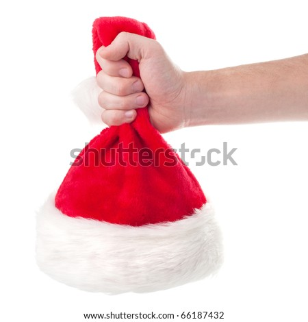 Hand holding Santa Claus red hat