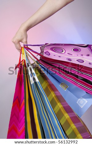 Hand holding shoping bags