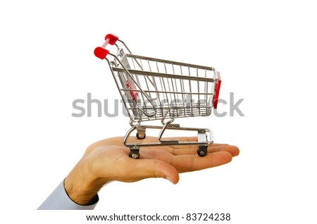 Hand holding shopping cart on white
