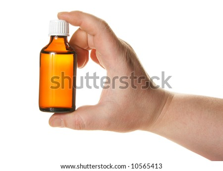 Hand holding small bottle with drug isolated over white background