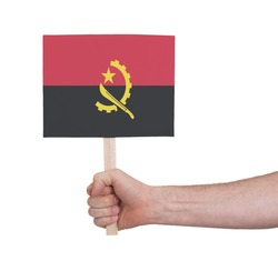 Hand holding small card, isolated on white - Flag of Angola