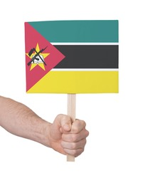 Hand holding small card, isolated on white - Flag of Mozambique