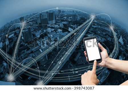 hand holding smart phone and city scape with network connection concept