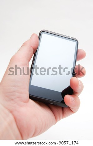 Hand holding smart phone mobile device over a white background.