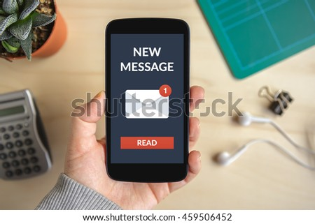 Hand holding smart phone with new message concept on screen. All screen content is designed by me #459506452