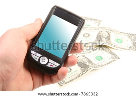 Hand holding smartphone. Bank notes on the background.