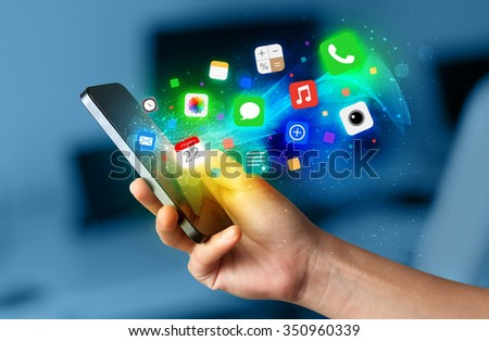 Hand holding smartphone with colorful app icons concept #350960339