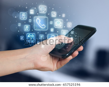 Hand holding smartphone with glowing mobile app icons