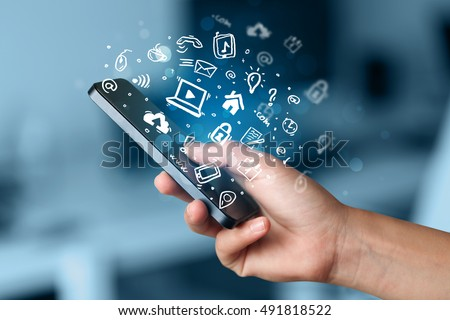 Hand holding smartphone with media icons and symbol collection #491818522