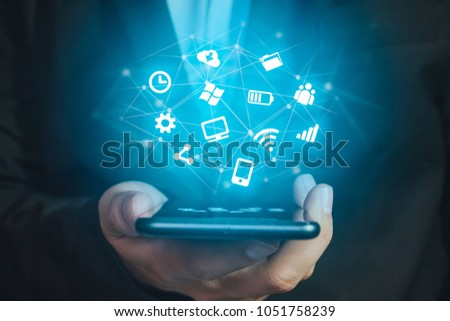 hand holding smartphone with...