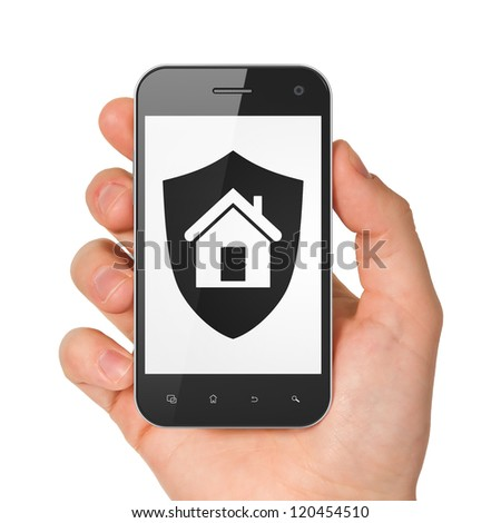 Hand holding smartphone with shield on display. Generic mobile smart phone in hand on white background.