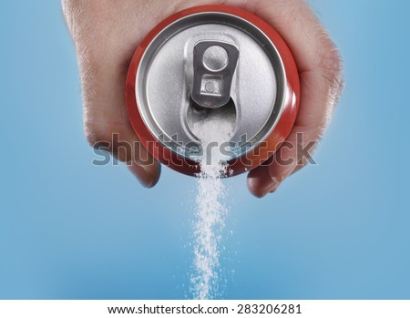 Shutterstock hand holding soda can pouring a crazy amount of sugar in metaphor of sugar content of a refresh drink isolated on blue background in healthy nutrition, diet and sweet addiction concept