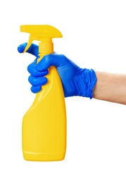 hand holding spray bottles isolated against white background. close up