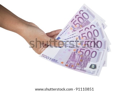 Hand holding stack of 500 Euro banknotes. Euro banknotes in hand isolated on white.