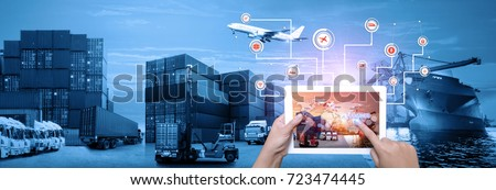 Hand holding tablet is pressing button on touch screen interface in front Logistics Industrial Container Cargo freight ship for Concept of fast or instant shipping, Online goods orders worldwide #723474445