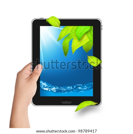 Hand holding tablet PC with falling leaves and water on screen