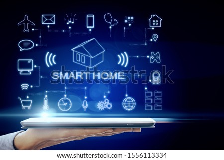 Hand holding tablet with concept of smart home technology system with centralized control. 3D Rendering